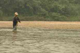 A fisherman at Teman Negara
