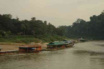 Floating restaurants line the river
