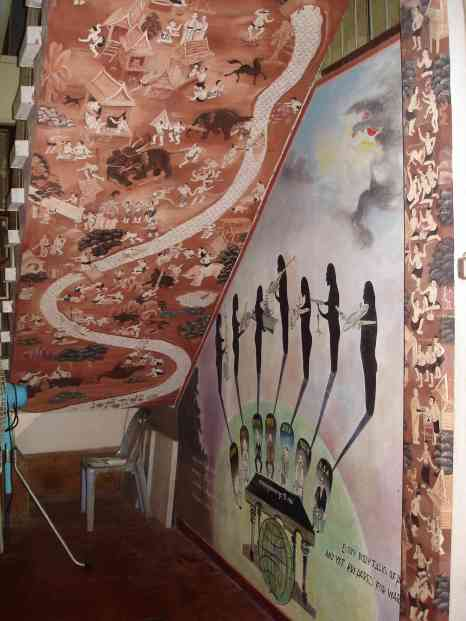 Various murals within a colourful Buddhist monastery