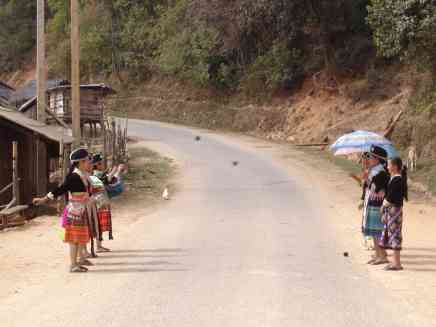 Hill-tribe girls playing an old Lao ball game