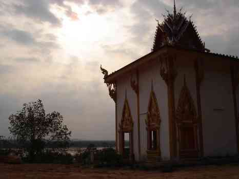 Sunset at a temple by the Mekong