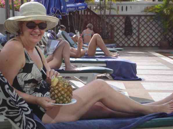 Mum, poolside with her cumbersome cocktail