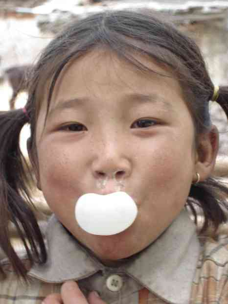 A cute, young, snotty Nepali girl