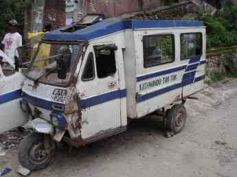 A tuk-tuk that's seen better days