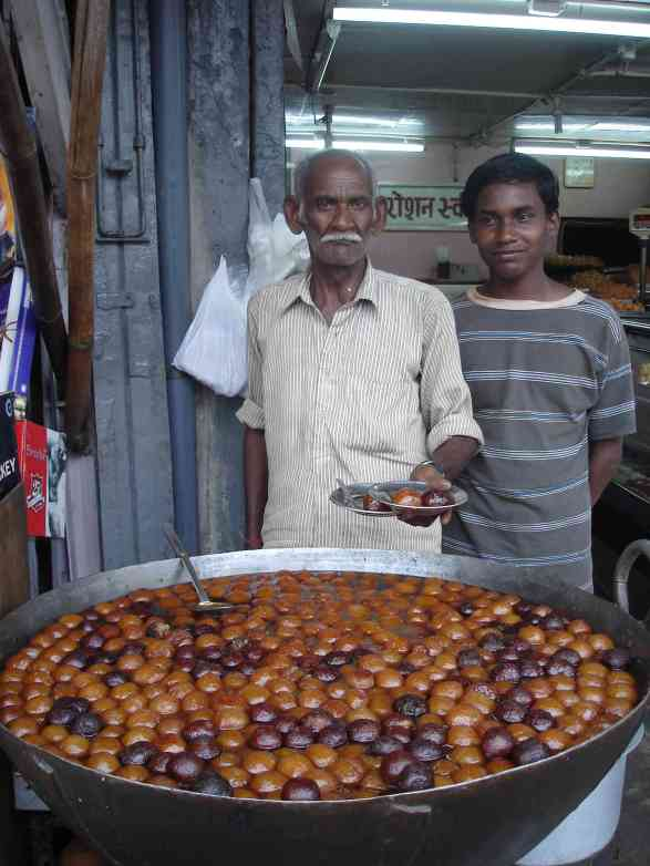A man and his son very proud of their gulab jamun