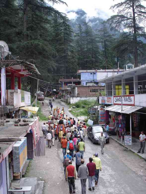 A religious procession through Kasol