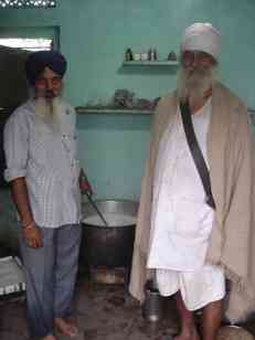 The milkman and my baba ji in his morning garb complete with dagger