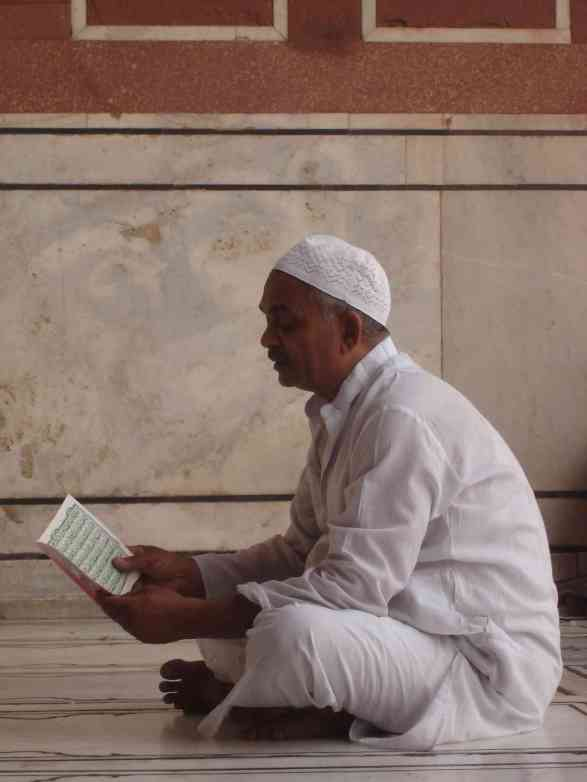 A devotee at Jama Masjid