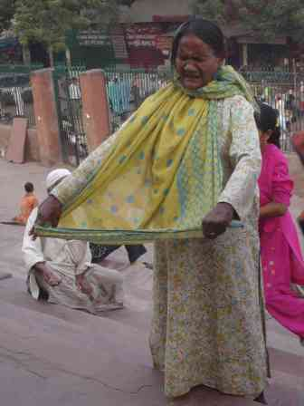 A singing beggar outside Jama Masjid