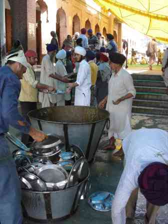 Volunteers pulling together at the Golden Temple's guru ka langar
