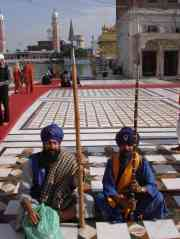 Two colourful devotees